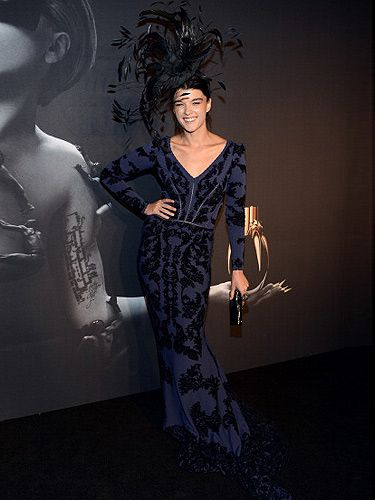 <p>Model Crystal Renn attended the Lady Gaga fragrance launch in a slim navy mermaid gown and a massive black feather headpiece. She looked like she came right out of the Black Swan movie!</p>