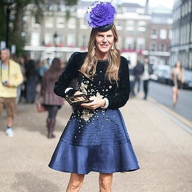 <p>We caught Anna Dello Russo outside the Topshop show at London Fashion Week looking absolutely amazing with that blue satin skirt and matching floral hat. The editrice is about to launch her accessories collection for H&M and we can't wait to get our hands on her blinging pieces!</p>