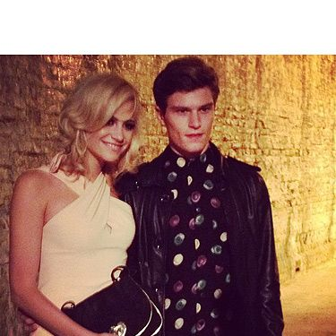 <p>Pixie Lott and her boyfriend Oliver Cheshire make a gorgeous pair, don't they? The two of them took their seat at the Moschino Cheap and Chic show looking adorable - and they couldn't keep their hands off one another.</p>