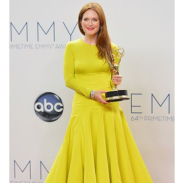 <p>Academy award nominated actress Julianne Moore won her first Emmy award for best actress in miniseries/movie for her brilliant performance as Sarah Palin in Game Change. She wore a gorgeous full-length yellow Dior couture dress with a radiant winner's smile. Congrats!</p>