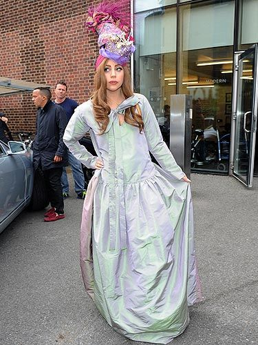 <p>Lady Gaga covered up in London with this mixed pastel dress by Vivienne Westwood. Of course, that wasn't enough of a statement for Lady Gaga so she added a headpiece that was full of fabric, feathers and jewels! Fab!</p>