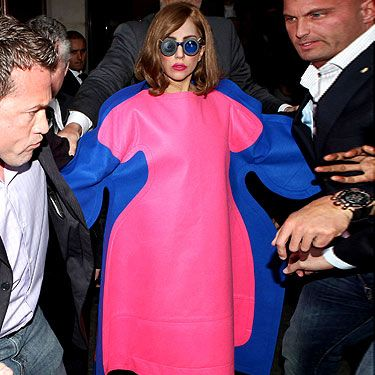 """<p>We love how Lady Gaga fights back with fashion and that's exactly what she did as she hit the streets of France in this pink and blue fat suit. Mocking those who said she had a 'fuller-figure' of late, Gaga not only wore this oversized ensemble but used her twitter account too. Lady Gaga posted a picture of the gorgeous Marilyn Monroe saying, """"To all the girls that think you're ugly because you're not a size 0, you're the beautiful one. It's society who's ugly."""" We couldn't have said it better ourselves, well done Gaga!</p>"""
