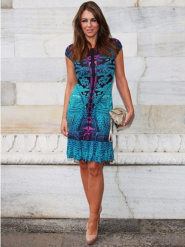 <p>The sexy actress Elizabeth Hurley showed up to the Roberto Cavalli show wearing a very Italian-inspired blue and purple dress with nude heels. We thought she did Milan Fashion Week proud with this bright and colourful ensemble!</p>