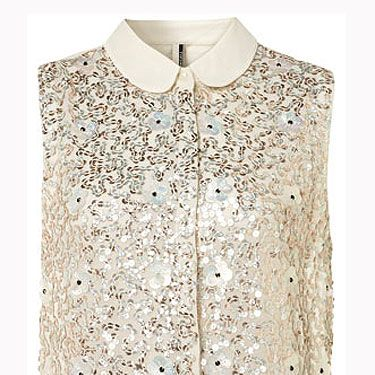 """<p>Oh, like a magpie we are drawn to anything glitzy and this gold number is no exception. Team with sequin shorts and heels.</p><p>Sequin and flower shirt, £48, <a href=""""http://www.topshop.com/webapp/wcs/stores/servlet/ProductDisplay?beginIndex=1&viewAllFlag=&catalogId=33057&storeId=12556&productId=6114551&langId=-1&sort_field=Relevance&categoryId=208524&parent_categoryId=203984&pageSize=20&refinements=category%7E%5B330497%7C208524%5D&noOfRefinements=1"""">Topshop</a></p>"""