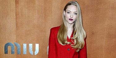 <p>We love Amanda Seyfried's colour-popping look on the Frow at the Miu Miu show in Paris. Wearing a mannish trouser suit in red, teamed with purple patent Mary Jane heels and a geometric print doctor's bag (this season's must-have shape!), the actress topped off her look with a vampy berry lip and poker straight hair. Talk about a head-to-toe look!</p>