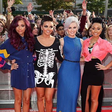 <p>Little Mix are getting in the swing of this red carpet malarkey. As the X Factor super group arrived at the BBC Radio 1 Teen Awards, the ladies posed like their lives depended on it. Our stand-out 'little muffin' (as Tulisa calls them) has to be Jesy and her skull print dress, Halloween chic but like, really really chic.</p>