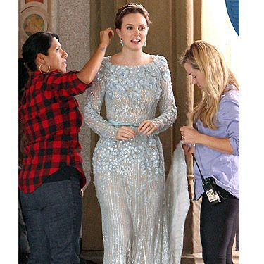 <p>Is this Blair Waldorf's wedding dress? We think so. The cast have been filming the last ever episode of Gossip Girl in New York, and by the looks of it, they're shooting a wedding scene. We love Leighton Meester's gorgeous dress - but what's with the worry on her face? We're scared.</p>