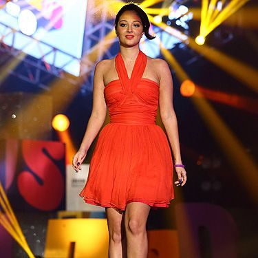 <p>Ravishing in red! Tulisa Contostavlos heated things up at the BBC Radio 1 Teen Awards wearing a fiery frock in an eye-catching tomato-red shade. The halter neck detail and fit 'n' flare skirt showcased Tulisa's best bits – plus her fierce black peep-toes made her legs go on forever. With her newly raven locks in a chic updo hairstyle and classically pretty makeup, we reckon Tulisa should have got the best-dressed award - not that such an award even exists.</p>