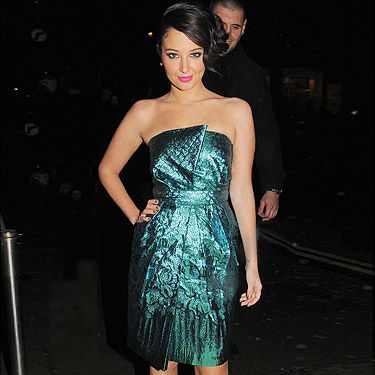 <p>Can X Factor judge Tulisa Contostavlos get any sexier? Cosmo's covergirl was out and about at the Aura night club in London in that metallic teal strapless dress with a bit of a futuristic patterning that made this outfit more sophisticated than her usual party ensembles. Along with black peep-toe heels and her hair tied in a side-bun, she looked super glam for a weekend night out. What a great look!</p>