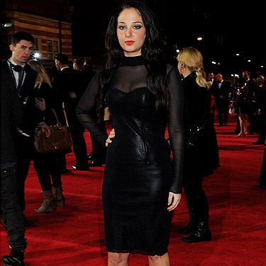 <p>Wow! After this smoking hot leather look, we wouldn't be surprised to see X factor judge Tulisa Contostavlos casted for a James Bond film. She showed up at the world premiere of Skyfall with this sexy skirt and top ensemble and paired it with strappy silver platform heels. Of course, the look couldn't be complete without a bright red lip. Hot!</p>