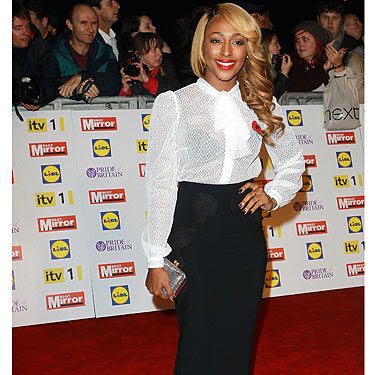 <p>Singer Alexandra Burke decided to go for a monochrome look to the 2012 Pride of Britain Awards. We're not entirely convinced of the black bra under the white pussy-bow blouse, but her glam hairstyle and ruby red lips makes up for her fashion fall.</p>