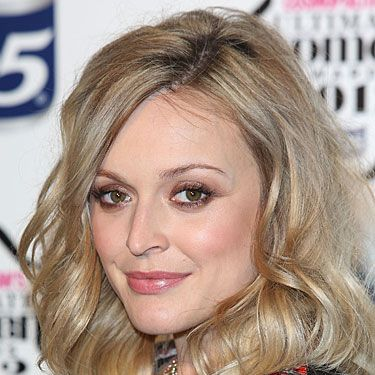 "<p>Wowzer! Fearne Cotton looked amazing on the red carpet of the Cosmopolitan Ultimate Women of the Year awards at Victoria & Albert Museum with a super sexy blowout hairstyle. Her mid-length hair was curled in giant waves for a fun, party hairstyle we'll definitely keep in mind for our next night out. <a href=""http://female.vo5.co.uk/products/give-me-texture/#choppy-cream-wax"" target=""_blank"">Vo5 Choppy Cream Wax</a> works wonders on scoring this choppy hairstyle by giving you that sticky texture to mould your hairstyle any way you fancy!</p>"