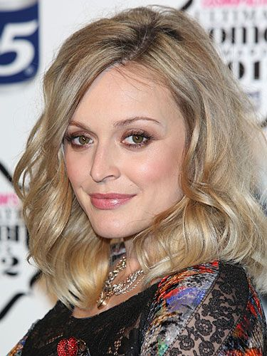 """<p>Wowzer! Fearne Cotton looked amazing on the red carpet of the Cosmopolitan Ultimate Women of the Year awards at Victoria & Albert Museum with a super sexy blowout hairstyle. Her mid-length hair was curled in giant waves for a fun, party hairstyle we'll definitely keep in mind for our next night out. <a href=""""http://female.vo5.co.uk/products/give-me-texture/#choppy-cream-wax"""" target=""""_blank"""">Vo5 Choppy Cream Wax</a> works wonders on scoring this choppy hairstyle by giving you that sticky texture to mould your hairstyle any way you fancy!</p>"""