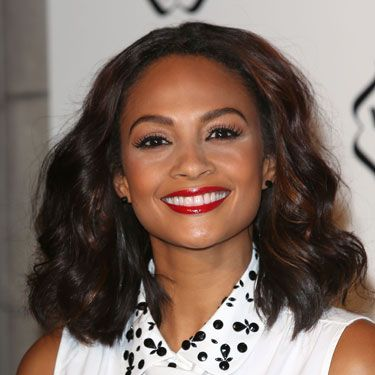"<p>Ooh, we loved Alesha Dixon's smooth wavy hair at the Cosmopolitan Ultimate Women of the Year awards at Victoria & Albert museum. She paired it with a brilliant red lip for that ultra catty beauty look we love so much. To get the look, scrunch in some <a href=""http://female.vo5.co.uk/products/smoothly-does-it/#curl-defining-mousse"" target=""_blank"">Vo5 Curl Defining Mousse</a> to score these amazing curls without the frizz.</p>"