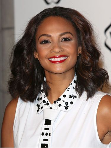 """<p>Ooh, we loved Alesha Dixon's smooth wavy hair at the Cosmopolitan Ultimate Women of the Year awards at Victoria & Albert museum. She paired it with a brilliant red lip for that ultra catty beauty look we love so much. To get the look, scrunch in some <a href=""""http://female.vo5.co.uk/products/smoothly-does-it/#curl-defining-mousse"""" target=""""_blank"""">Vo5 Curl Defining Mousse</a> to score these amazing curls without the frizz.</p>"""