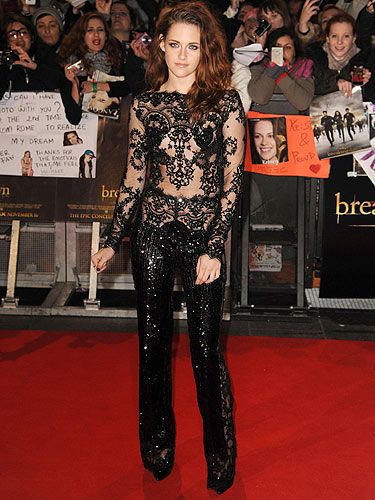 <p>As you'd expect, Kristen Stewart vamped it up for the London premiere of The Twilight Saga Breaking Dawn Part 2.</p> <p>Dressed in a black lace Zuhair Murad jumpsuit with  a smattering of sequins to protect her modesty, KStew looked bewitching - espesh teamed with fierce Louboutin heels, tousled hair and vampy nails.</p> <p>And with the open detail to the reverse, Kristen sure is bringing sexy back!</p>