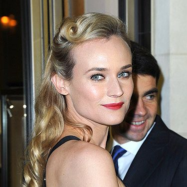 <p>Diane Kruger sported an awesome retro hairstyle at the Jaeger store opening in Paris. She wore her hair half up with two victory rolls at the sides curled to perfection. The best way to work this classic vintage trend is with soft eye makeup and fierce matte red lips. We couldn't have done it better ourselves!</p>