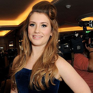 <p>X factor contestant Ella Henderson attended a drinks reception at the Amy Winehouse Foundation Ball in London rocking a gorgeous vintage hairstyle. She wore her hair in soft waves and tied up her fringe in an awesome victory roll. She was definitely channelling Amy Whinehouse with this retro hairstyle and fierce cat-eye makeup! </p>