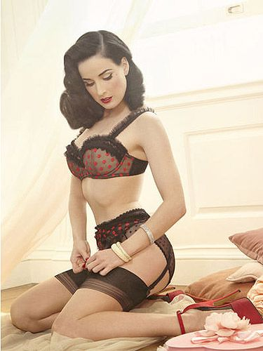 "<p>Dita Von Teese launches her vintage-inspired underwear line Von Follies by Dita Von Teese in the UK today.</p> <p>The glamorous vintage-inspired lingerie line, which Dita describes as an ""homage to femininity"" will be available in Debenhams.</p> <p>Dita designed the collection herself and her trademark retro style is clear to see, with fishnet detailing, loadsa lace, elaborate bustiers, ornate balcony bras, fitted chemises, high-waisted briefs and garter belts.</p> <p>And all in the burlesque star's super sexy signature shades of red, black and nude. Swit-swoo!</p> <p>Seems there's something for everyone in this range. Says Dita:</p> <p>""I am thrilled to be able to launch this signature collection at Debenhams and make these exquisite, vintage-inspired designs available to women throughout the UK.</p> <p>""It's important to me that this collection is accessible to all women - I have designed these beautiful pieces to flatter women of all shapes and sizes.""</p> <p>Shop Von Follies by Dita Von Teese at <a title=""Von Follies by Dita Von Teese lingerie at Debenhams"" href=""http://www.debenhams.com/webapp/wcs/stores/servlet/Navigate?ps=max&storeId=10001&pn=1&lid=%2F%2Fproductsuniverse%2Fen_GB%2Fproduct_online%3DY%2Fcategories%3C{productsuniverse_153156}%2Fbrand_description%3E{von20follies20by20dita20von20teese}&catalogId=10001"">Debenhams</a>.</p>"