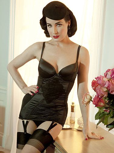 "<p>Dita Von Teese in covers-up shocker!</p> <p>We're more used to seeing the Burlesque star in nipple tassels and not-much-else, but we're loving this beauts black basque.</p> <p>Get a killer curvy figure just like Dita's (well, nearly) via Von Follies by Dita Von Teese, available from <a title=""Von Follies by Dita Von Teese lingerie at Debenhams"" href=""http://www.debenhams.com/webapp/wcs/stores/servlet/prod_10001_10001_161010819573_-1?breadcrumb=Home~Lingerie"" target=""_blank"">Debenhams</a>.</p>"