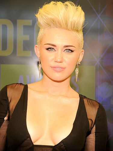 <p>Miley Cyrus is known more for her hair than her ample cleavage. But that doesn't mean she hasn't got an impressive set of lady lumps. But if you're thinking that they're fake, then don't! She has denied speculation that she went under the knife for a breast enlargement. After wearing a revealing dress on the red carpet, she tweeted: 'Thank you for the compliment but these babies are all mine,' she tweeted. She then followed it up with: 'I wish they'd realize you don't have to be fake to be beautiful!'</p>