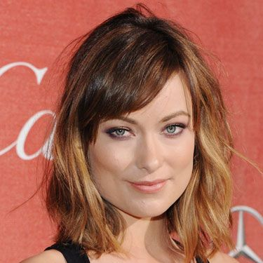 <p>Tron starlet Olivia Wilde stepped out on the red carpet sporting a new, freshly-cut hairstyle that's worlds away from her long, dark locks of the past. Adding a subtle but very effective ombre tint to the ends of her beach-waved bob has given her new hair a soft but suitably edgy look – and we love her short side-fringe, too. Top marks Olivia!</p>