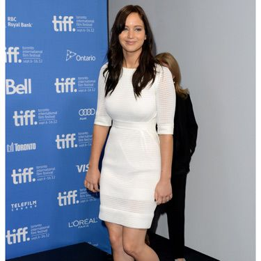 Jennifer Lawrence ditched the traditional LBD in favour of a chic white mini for this Silver Linings Playbook press junket. The ladylike showed off her toned figure to perfection, while the loose undone hair and simple bronze heels helped the dress to do all the talking for her. We loved it!