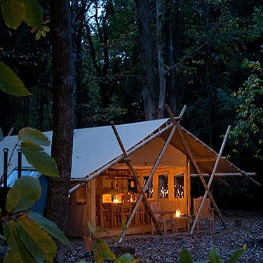 """<p>Forget your average tent&#x3B; Country House Hideout's canvas creations are bigger than your average flat – and much cooler.</p><p>There's a massive table, running water, beds for six and a hot tub – while you wait for it to fill, take turns to pedal a bike linked to a battery which stores electricity so you can light up your tent at night. Genius.</p><p>Camps are in the grounds of posh country houses in Essex, Lancashire, <span>Shropshire and the Scottish borders, </span>for prices check (<a title=""""www.countryhousehideout.co.uk"""" href=""""http://www.countryhousehideout.co.uk"""" target=""""_blank"""">countryhousehideout.co.uk</a>). </p><div> </div>"""