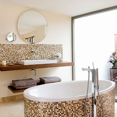 """<p><a title=""""www.scarlethotel.co.uk"""" href=""""http://www.scarlethotel.co.uk"""" target=""""_blank"""">The Scarlet Hotel</a> in Cornwall is proof eco can mean luxe.</p><p><span>Built on a cliff top overlooking Mawgan Porth beach, it's got </span>37 rooms, ranging from Just <span>Right to Indulgent, with floor-</span>to-ceiling windows, terraces, funky furniture and huge tubs big enough for two.</p><p>The <span>food in the huge restaurant is locally sourced and the glitzy </span>bar is more Manhattan than <span>Mawgan Porth. </span></p><p><span>If you manage </span>to make it out of the spa's hanging relaxation pods after your massage, then <span>jump in an outside hot tub or </span>have a go at surfing.</p><p>Visit <span><a title=""""www.scarlethotel.co.uk"""" href=""""http://www.scarlethotel.co.uk"""" target=""""_blank"""">Scarlethotel.co.uk</a> for prices.<br /></span></p><div><span><br /></span></div>"""