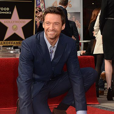 """<p>He's been amazing eye candy in films such as X-Men, Wolverine, Real Steel and now the awesome Les Misérables, so it was only fair that Hugh Jackman got his Hollywood Walk of Fame star this week! Looking totally desireable in his blue suit with his two gorgeous co-stars Anne Hathaway and Amanda Seyfried on his arm, Hugh couldn't have looked more hot if he tried. Go Hugh!</p><br /><p><strong>More sex and celebrity pictures</strong><br /><a href=""""http://www.cosmopolitan.co.uk/celebs/entertainment/90s-tv-crushes-then-now"""" target=""""_blank"""">What are your 90s celebrity crushes are up to these days?</a><br /><a href=""""http://www.cosmopolitan.co.uk/love-sex/tips/"""" target=""""_blank"""">Best sex tips for men and women</a><br /><a href=""""http://www.cosmopolitan.co.uk/celebs/entertainment/"""" target=""""_blank"""">Latest entertainment news</a></p>"""