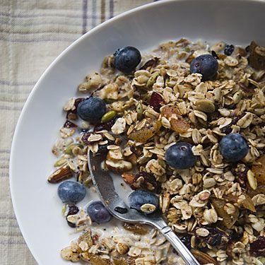 """<p>Most 'healthy choice' muesli brands are the picture of innocence on the outside, but inside a community of sugar coated flakes bond with hardened vegetable oils. It is a hard fact to swallow that these 'healthy staples' can actually contribute toward fluctuating blood sugars and raised cholesterol levels. Our solution? Make your own batch to see you through the week!</p><p>Choose 3 different grains from your local health store, such as rolled oats or rice, rye or barley flakes. Mix them together in a large bowl and add a splash of liquid coconut oil (the healthiest oil around! For why check out the Food Fairies article <a title=""""http://foodfairynutrition.com/blog/supercharge-your-morning/"""" href=""""http://foodfairynutrition.com/blog/supercharge-your-morning/"""" target=""""_blank"""">here</a>) to cover each flake lightly.</p><p>Evenly spread onto a baking tray and bake for 30-40 min.</p><p>Add nuts, seeds and fresh berries of choice, spoon in some live natural yoghurt and you have a delicious breakfast sans a dollop of sugar!</p>"""