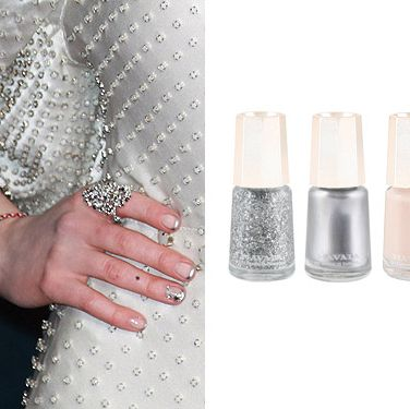 <p>Actress Anne Hathaway stepped out in a gorgeous white dress at the Les Miserables premiere, but we couldn't stop gawking at her nails. Mavala brand ambassador Jenni Draper opted for a modern French manicure design, using Mavala's Reno as a base and Mavala's Silver on the tips. She then added Mavala's Sparkling Silver glitter and some rhinestones to glam it up a notch.</p>