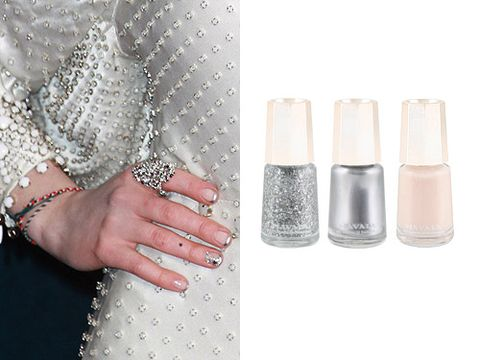 "<p>Actress Anne Hathaway stepped out in a gorgeous white dress at the Les Miserables premiere, but we couldn't stop gawking at her nails. Mavala brand ambassador Jenni Draper opted for a modern French manicure design, using Mavala's Reno as a base and Mavala's Silver on the tips. She then added Mavala's Sparkling Silver glitter and some rhinestones to glam it up a notch.</p> <p>Mavala Nail Polish, £4.30, <a href=""http://www.johnlewis.com/309379/Product.aspx"" target=""_blank"">John Lewis</a></p>"