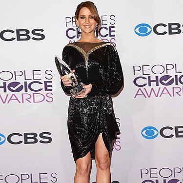 <p>Jennifer Lawrence looked gorgeous at the 2013 People's Choice Awards. The Hunger Games actress (who took home four awards!) was dressed to kill in her Jennifer looked gorgeous in a Valentino Couture dress with Nicholas Kirkwood shoes, a Valentino Couture clutch, and Cartier jewels.</p>