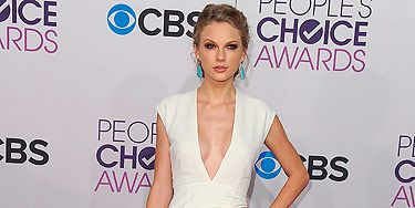 <p>Taylor Swift looked angelic on the red carpet at the 2013 People's Choice Awards. The 23-year-old singer made her first public appearance since her split from Harry Styles just a few days ago - and we think her glum face says it all. Taylor opted for a Ralph Lauren Collection dress and Christian Louboutin shoes.</p>