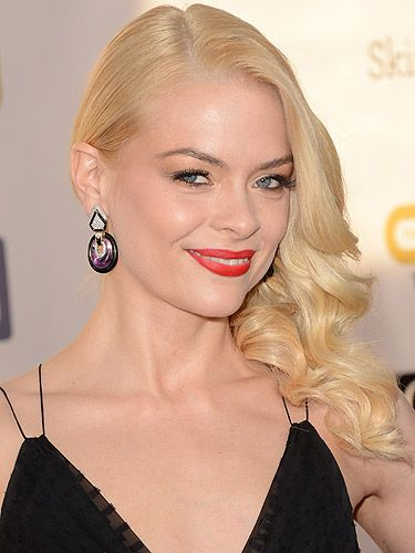"""<p>Ooh, is it getting hot in here? Jaime King was sizzling on the red carpet at the 2013 Critics' Choice Awards with those bright shimmery red lips. We love how she swept her hair to the side in long, wispy waves for a super glamorous old Hollywood beauty look.</p> <p>To get the look, try <a href=""""http://www.boots.com/en/Max-Factor-Colour-Effect-Flipstick_1257596/"""" target=""""_blank"""">Max Factor Colour Effect Flipstick</a> in Salsa Red - add the shimmer bit to the centre of your lips to make them appear fuller.</p>"""