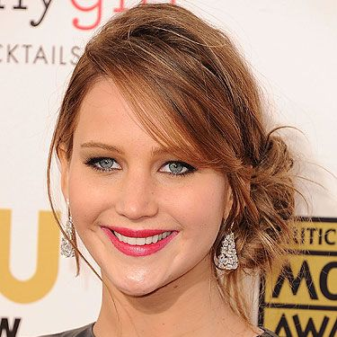<p>Jennifer Lawrence is ON FIRE! Check her out in a messy side-bun hairstyle and  berry-red lips at the 2013 Critics' Choice Awards. She went home with the awards for Actress in a Comedy Movie and Actress In An Action Movie - you go girl!</p>