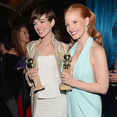 <p>Anne Hathaway and Jessica Chastain looked proud as punch as they showed off their Golden Globe awards for their performances in Les Mis and Zero Dark Thirty. They even messed around later and had a mock fight using their awards as swords. Too cool.</p>