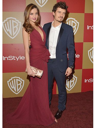 <p>Yippee! Miranda Kerr and Orlando Bloom prove they are still together as they pose at the 2013 Golden Globe Awards. The 29-year-old Victoria's Secret supermodel and her 36-year-old hubby looked hot-to-trot. Miranda wore a Zuhair Murad burgundy chiffon gown featuring a plunging neckline and high slit. Orlando looked gorgeous in head-to-toe Burberry.</p>