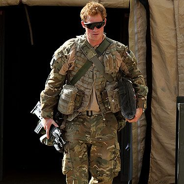<p>While on duty as an Apache helicopter pilot, the man known as Captain Wales - or Prince Harry as we like to call him - has just finished a stint in Afghanistan -  after five months on the job. We think he looks pretty hot in camouflage and sunglasses as he left the country on an aircraft, the prince was taken to an undisclosed location for a 24-hour 'decompression' period alongside other troops.</p>