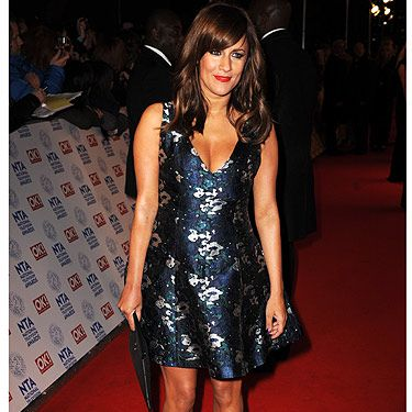 <p>NEWSFLASH: Caroline Flack did NOT wear shorts to the National Television Awards. We think she looks HOT with her skater dress, heels and new brunette locks.</p>