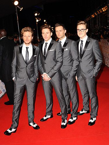 <p>It was coordination central at the NTAs as the McFly boys rocked matching grey suits on the red carpet. Looking FINE, fellas! Harry, Tom, Dougie and Danny entertained the crowds as they presented an award, although Tom was in a bit of a panic later when he realised he'd lost his wedding ring. Luckily for him his wife found it at home – oops. </p>