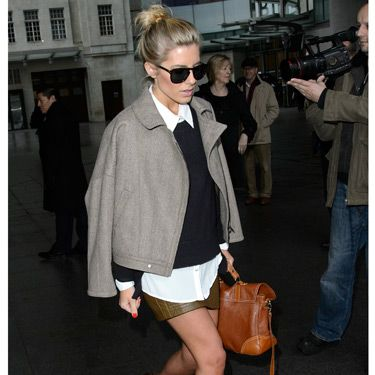 <p>Ooh, look! Mollie King is doing the Victoria Beckham-coat-on-shoulders thing - and she's working it! This outfit is very different for Mollie&#x3B; it's almost preppy. We gotta say, we love her for trying out a new look. The Saturdays babe was leaving the BBC Radio One studios in London, but brrr, are those bare legs?</p>