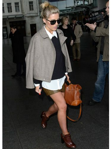 <p>Ooh, look! Mollie King is doing the Victoria Beckham-coat-on-shoulders thing - and she's working it! This outfit is very different for Mollie; it's almost preppy. We gotta say, we love her for trying out a new look. The Saturdays babe was leaving the BBC Radio One studios in London, but brrr, are those bare legs?</p>