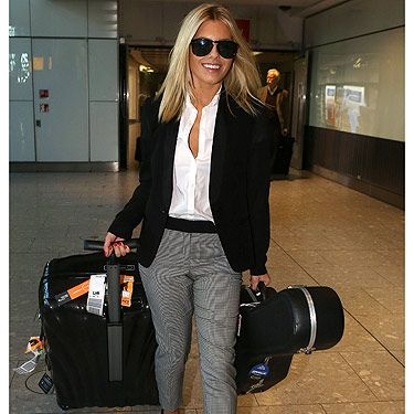 <p>Um, why do we not look like this when we emerge from a long-haul flight? No fair! Mollie King touched down at Heathrow airport looking incredible in this airport ensemble of cropped trousers, a crisp white short and a blazer. Mollie completed her outfit with sleek hair and a pair of sunglasses.</p>