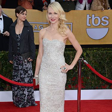 "<p class=""p1"">The Impossible actress Naomi Watts never puts a fashion foot wrong. The 44-year-old acress wore a silver Marchesa gown with Christian Louboutin shoes, a gorge Faberge ring and earrings and a Salvatore Ferragamo clutch bag. We loved her SAG Awards beauty look also&#x3B; ruby red lips, Veronica Lake waves and sea green nails.</p>"