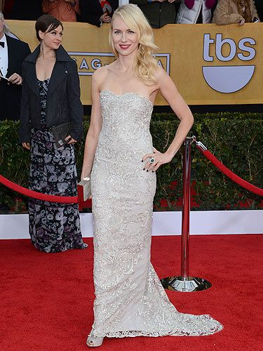 "<p class=""p1"">The Impossible actress Naomi Watts never puts a fashion foot wrong. The 44-year-old acress wore a silver Marchesa gown with Christian Louboutin shoes, a gorge Faberge ring and earrings and a Salvatore Ferragamo clutch bag. We loved her SAG Awards beauty look also; ruby red lips, Veronica Lake waves and sea green nails.</p>"