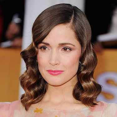 "<p>Rose is on fire right now. Check out this high-shine 'do which top hair stylist Errol Douglas describes as ""neither pin curls nor full length loose vintage waves, but a creation in between"". Whatever – it works! We also appreciate the mid-pink lippy which offsets her dress a treat. Shine spray essential. Try Morrocanoil Glimmer Spray for Rose-worthy sparkle.</p>"