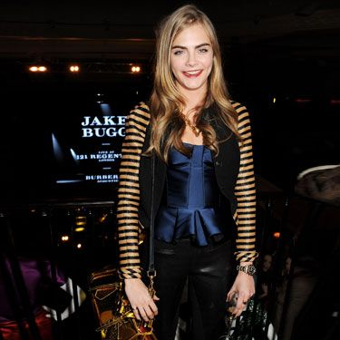 <p>Brit model Cara Delevingne left her beloved onesie at home last night for the exclusive Jake Bugg show for Burberry.</p><p>Getting her rawk on without a frock on, Cara (who is also face of the brand) donned pieces from the latest Burberry collection (natch): a striped jacket with a peplum satin top and leather trousers.</p><p>And we're seriously lusting after her leccy blue heels and perspex yellow Blaze handbag.</p>