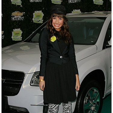 <p>Rewind five years and we can see that Demi has always had great style. The zebra leggings keep the outfit looking young and fun. The fact she's at an event involving cars, the chauffeur-esque hat is the perfect accessory. Cute!</p>